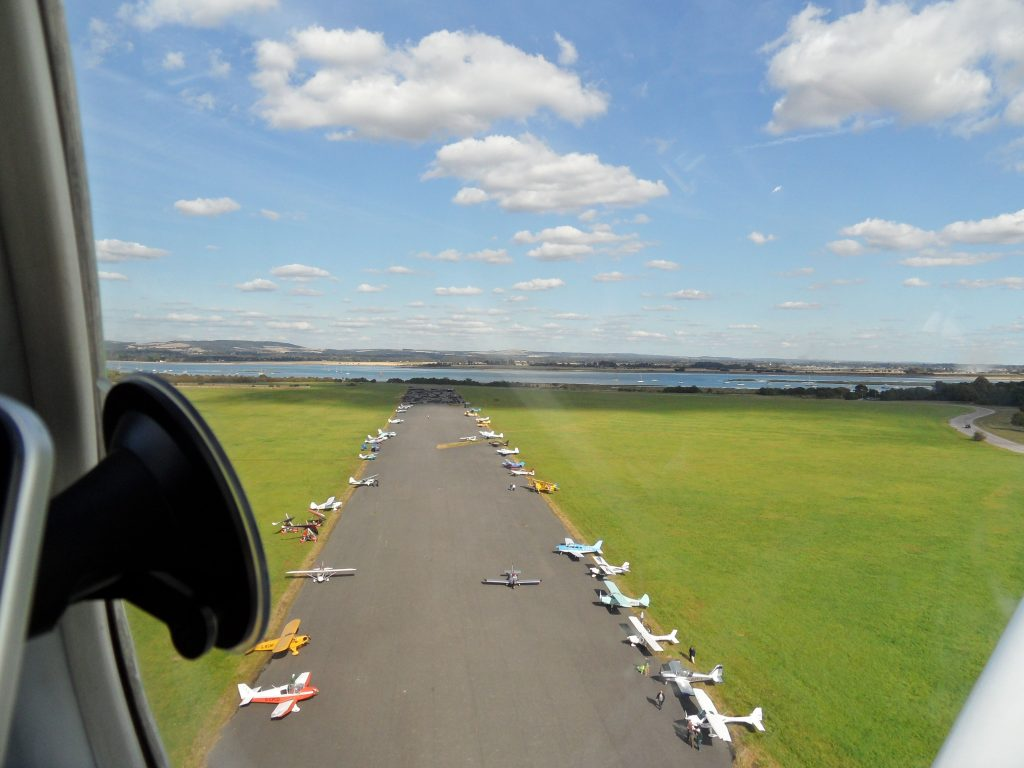 On climbout, we were already well above the parked aircraft on the cross runway