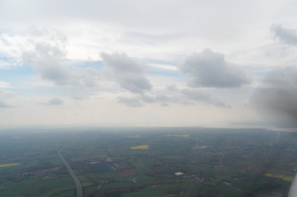 Looking south west overhead M5 towards Severn Estuary