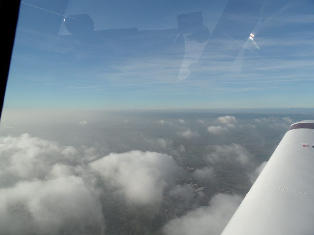On top of broken cloud layer at FL50