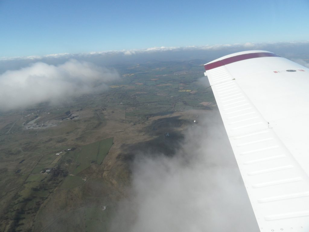 Above the clouds at 4000 feet with the snow capped Welsh mountains in the distance