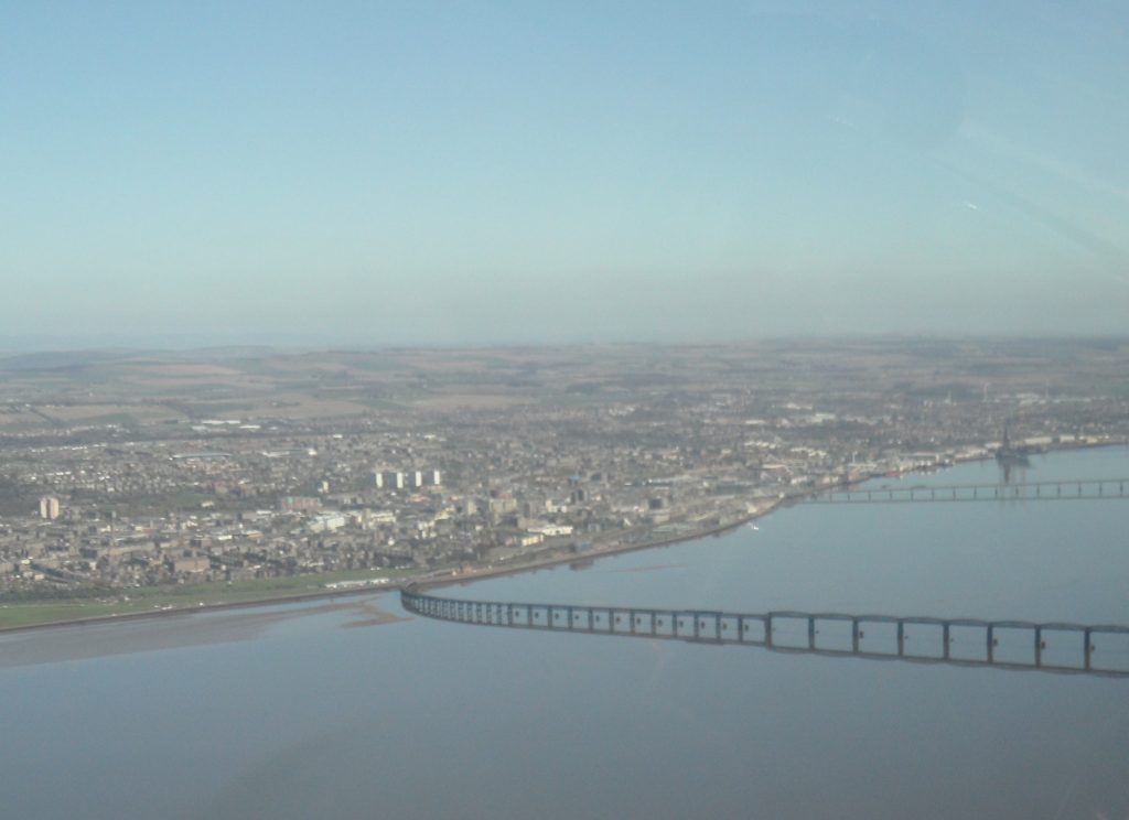 Downwind, heading east, both rail and road bridges marking the centre of Dundee City