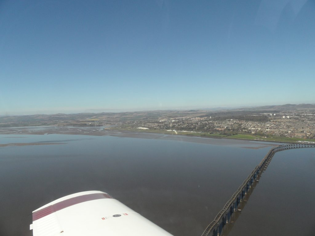 Turning base leg with Dundee airport in the centre of the picture, rail bridge in view