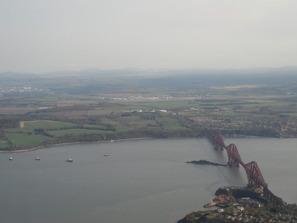 Forth Rail Bridge with Edinburgh airport on far side
