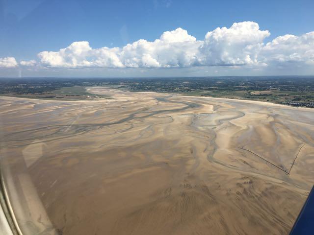 Huge sandy inlet at low tide